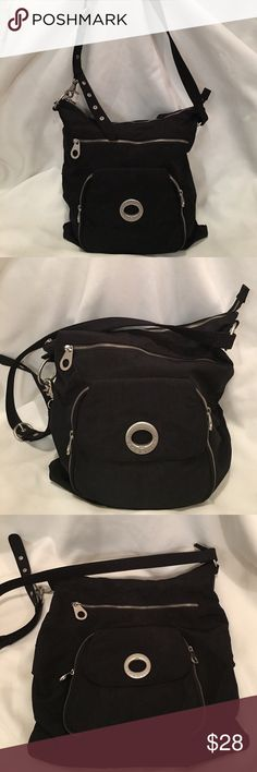 "Like new black baggallini crossbody bag Sleek stylish black adjustable crossbody baggallini in like new condition inside and out. Dimensions 14"" across 14"" height 3"" depth strap drop 23"" at its longest 3 outside zip pockets- front has  small zip compartment and 6 slip pockets and 2 little pockets. Another large zip pocket in front and one in back.2 zip pockets inside and 2 pockets. Baggallini Bags Crossbody Bags"