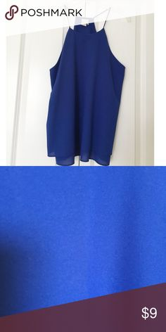 Cobalt blue gorgeous tank! This shirt has never been worn. It is a beautiful cobalt blue color. It features a racer back style with spaghetti straps. It is made of 100% polyester. Paper Crane Tops Tank Tops