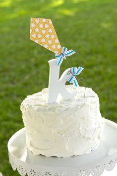 @Andrea Collins : this adorable kite cake topper could easily be made more masculine.