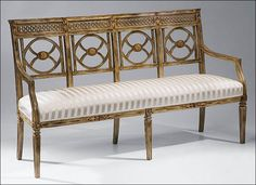Neoclassic style carved beechwood settee with antiqued hand-rubbed finish, antiqued goldleaf accents and ivory upholstery. Made in Italy