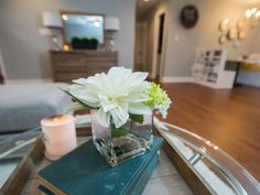 The newly renovated Silva home features polished metal, glass and antique book accents.