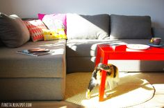 Grey sofa and red coffee table