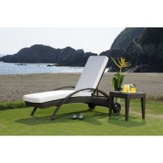 Kick back and relax in style with the Hospitality Rattan Soho Patio Chaise Lounge Set - Rehau Fiber Java Brown.
