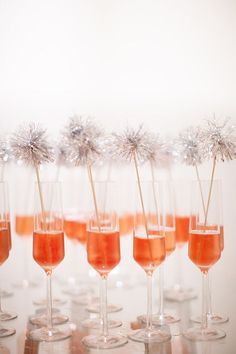 Pom Sparkle Stirrers. Instructions on how to DIY here: http://www.marthastewart.com/307565/tinsel-drink-stirrers