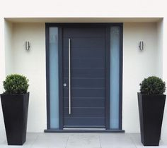 design serendipity: Modern Door Galore - Gray panelled door instead of Navy, with oversized hardware and side wall lights