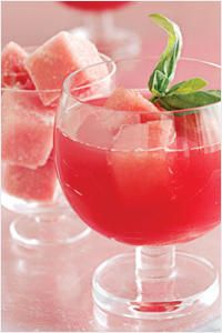 Watermelon Basil Martini  7 1/2 pounds seedless watermelon, rind removed, fruit cut into 1-inch cubes 4 tsp superfine sugar 6 oz (3/4 cup) silver tequila 24 basil leaves plus sprigs for garnish 3 oz triple sec