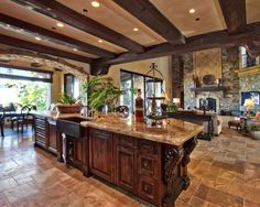 Mediterranean Kitchen Design. I like the mix of the wood on the ceiling and rock on the fireplae