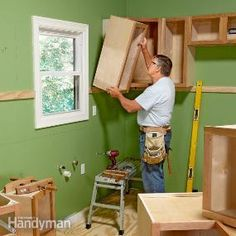 How to Install Cabinets. A cabinet maker takes you step by step how to hang them the right way the first time.