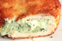 Spinach Dip Chicken Bombs - Makes 8 INGREDIENTS 1 tablespoon olive oil 5 ounces baby spinach Salt and pepper 8 ounces cream cheese 1 cup shredded mozzarella . Spinach Artichoke Chicken, Spinach Dip, Spinach Stuffed Chicken, Baby Spinach, Artichoke Dip, Spinach Bread, Artichoke Hearts, Chicken Bomb Recipes, Chicken Bombs