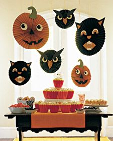 Martha shows you how to craft Halloween hang-ups -- floating, spinning, spooky visages that will draw extra attention to a table of goodies.