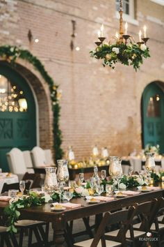 Garland and candle covered tablescape: http://www.stylemepretty.com/maryland-weddings/baltimore/2015/11/24/romantic-evergreen-museum-and-library-wedding/   Photography: Readyluck - http://www.readyluck.com/