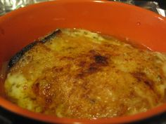 French onion soup: caramelized red onions, topped with toasted baguette slice and pepperjack cheese, broiled to perfection
