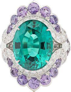 Seven Seas Collection ~ Nœud Marin ring : Oval-cut green tourmaline of10.78 carats, mauve sapphires, diamonds © Van Cleef &Arpels<