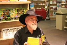 Beloved fantasy author Terry Pratchett has died at the age of according to a message from his publishers. Best known for the Discworld novels, Pratchett wrote more than 70 books, blending. Fantasy Authors, Fantasy Books, Discworld Books, Disney Planes, Terry Pratchett, Online Library, Rest In Peace, Dance Moms, Funny Stories