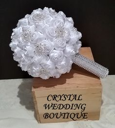 White satin rolled roses interspersed with Swarovski crystals and lots of added bling