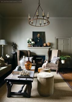 moody + handsome. nailhead wingback chairs, distressed wood table, antiques, and organic details.
