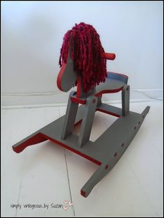 This started out as a plain old wooden rocking horse, but has since been transformed with chalk paint and yarn from simply vintageous...by Suzan: A home for a Rocking Horse ( vintage rocking horse makeover )
