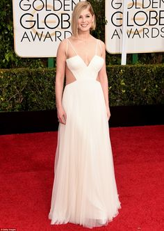 White hot: Rosamund Pike wore an ethereal layered white chiffon Vera Wang gown with daring...