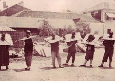 Chinese prisoners wearing a cangue.  A cangue is a small device that was used for public humiliation and corporal punishment in China and some other parts of East Asia and Southeast Asia, until the early years of the 20th century.  It was somewhat similar to the pillory used for punishment in the West, except that the board of the cangue was not fixed to a base, and had to be carried around by the prisoner.