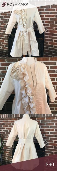 Ryu  Spring / Summer Coat It is beautifully designed coat. Artsy but not too fancy. I love it but now it is too small for me. Size L but runs small and will fit S/M. 50% polyester, 50% cotton. Used few times but still  looks great. Anthropologie Jackets & Coats