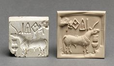 Stamp seal and a modern impression: unicorn or bull and inscription [Indus Valley] (49.40.1) | Heilbrunn Timeline of Art History | The Metropolitan Museum of Art