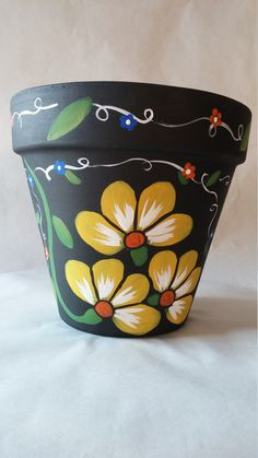 Brighten up any living space with this beautiful hand painted clay pot in vibrant yellow flowers. Good earth pot has been hand painted in acrylic paint and has been sealed. This is a nice size pot which measures inches wide and 8 inches tall Flower Pot Art, Flower Pot Design, Clay Flower Pots, Flower Pot Crafts, Clay Pots, Clay Pot Projects, Clay Pot Crafts, Painted Plant Pots, Painted Flower Pots