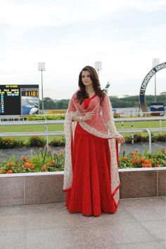 Aishwarya Rai Bachchan at the Longines Watches -Singapore Gold Cup Event. Love this red SABYASACHI creation. Indian Gowns Dresses, Indian Fashion Dresses, Dress Indian Style, Indian Designer Outfits, Pakistani Dresses, Indian Outfits, Fashion Outfits, Woman Dresses, Women's Fashion