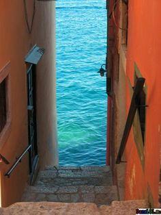 Stairs down to the blue sea, Rovinj, Croatia.