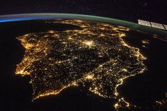 Spain and Portugal glow at night. The city of Madrid is the bright spot just above the center of the picture.