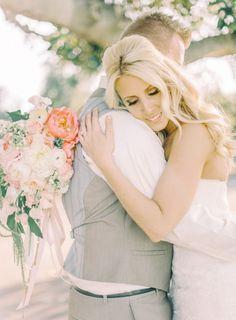 A loving hug: http://www.stylemepretty.com/california-weddings/camarillo/2015/02/06/rustic-glamour-camarillo-ranch-wedding/ | Photography: Mariel Hannah - http://www.marielhannahphoto.com/