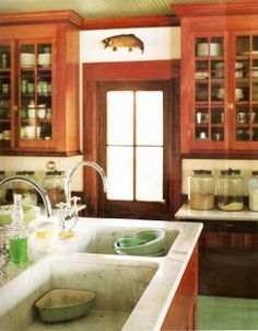 yummy marble sink and countertops - do I dare do marble? Not likely.. Love the Jadeite floor too and the wood cabinets! From MARTHA MOMENTS: lily pond lane