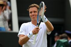 Tomas Berdych applauds after his First round victory over Victor Hanescu