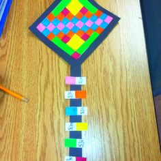 """""""Kite- fraction using 6 colors and 64 squares, I did this with my 2nd grade."""" YES I need projects like this to help ME get through teaching math!"""
