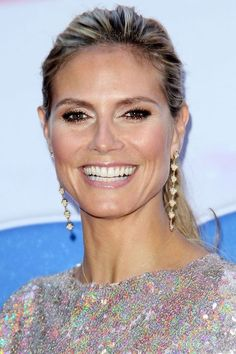 Feeling pasty? Take some shimmery bronzer and dust it on the perimeter of your face for a sun-kissed glow without looking faux-tanned! Add some sparkly gold detail around the eyes to finish it off, like Heidi!
