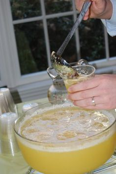 BANANA SLUSH PUNCH!  I seriously just had this for the first time yesterday at brunch and it is my favorite now....so yummy!  4 cups granulated sugar   6 cups water   1-46 oz. can pineapple juice   46 oz. orange juice   5 fresh bananas, mashed   1/2 cup lemon juice   Three 2 liters gingerale