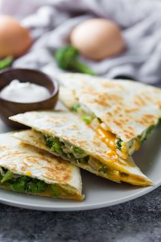 These freezer friendly broccoli cheddar breakfast quesadillas are going to have you leaping out of bed in the morning! Healthy, tasty and convenient.