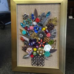 This gorgeous multi colored vase of flowers was handcrafted with much TLC using vintage and new jewelry items along with beads, pearls and rhinestones.