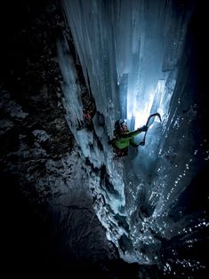 Picture of a climber ice climbing at night, Gran Paradiso, Italy