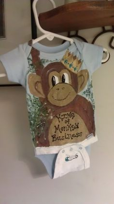 With fabric paint, I painted this monkey on a onsie for our new grand baby...I am hoping his legs will give the illusion of monkey legs when he is wearing it, and bring the whole thing alive :)