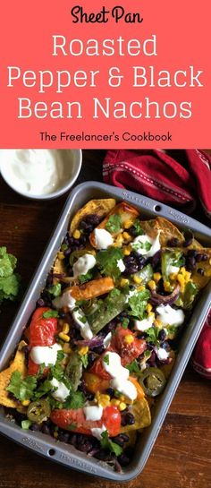 These loaded sheet pan nachos are super easy to make, and healthy too - they contain three portions of vegetables. A perfect quick weeknight dinner, lunch or snack. Ready in 35 minutes, containing bell peppers, red onion, black beans, sweetcorn, jalapeno #sheetpannachos #workingfromhome #freelancelife