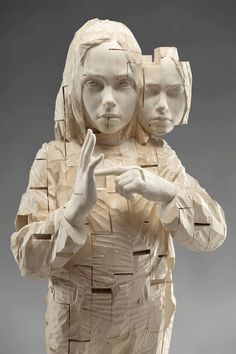 """Gehard Demetz  Demetz works primarily in wood, portraying children on a monumental scale, elevated on platforms and pedestals. Unlike the romanticized view of childhood as a time of innocence, Demetz's children are powerful figures—knowing, self-aware and bold.  """"My sculptures shall be children who appear adultly. They are aware of their existence. The consciousness what has been assigned on them and what expect them in the future."""""""