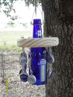 Beer bottle wind chime. Finally something to do with all of those bottle caps I've been saving!