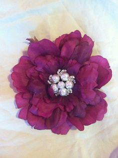 Girls flower hair clip nice in the right color of purple! or an orchid or just small beaded hair clip for matching bridesmaids hair piece