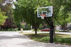 I like the curved drive...your hoop could be inside instead of outside of the curve.