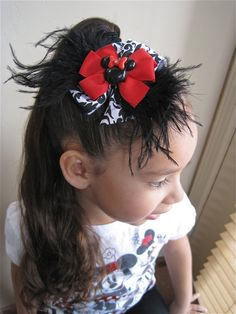 Minnie Mouse hair bow with damask ribbon.