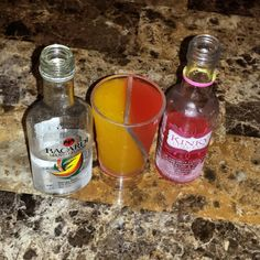 """Bacardi with a splash of Kinky Mango shots! Mmmhmmm hubby throwing them back! Our current situation! """"It's 5 o'clock some where"""" #Tipsybartender  #Danielleskitchen"""