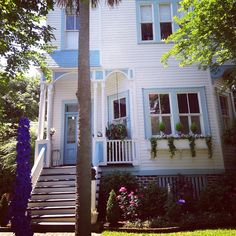 White house with blue accents in downtown Charleston, SC