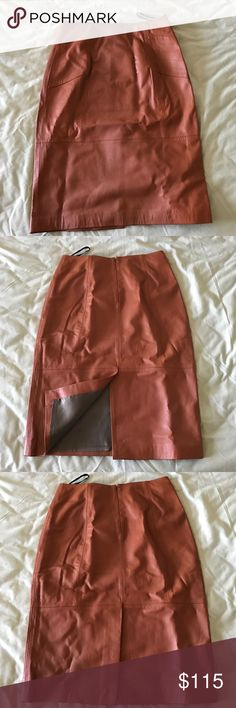 Brand new lamb leather pencil skirt in saddle This is a brand new (still in original packaging) baby lamb leather pencil skirt in a size S. It is soft and totally spectacular! Beautiful saddle brown color. Dress it up or down - you can't go wrong with this skirt! Elizabeth Roberts Skirts Pencil
