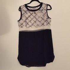 NWOT Saboskirt dress NWOT, brand new never worn, dress from Saboskirt. The top is sheer, but the bottom has black lining. Australian size 10, US size 6 Sabo Skirt Dresses Mini