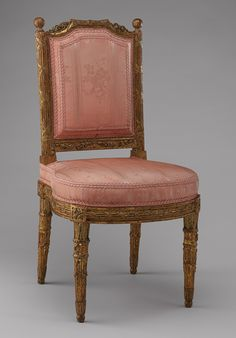 Side chair (chaise) (one of a pair), 1784 Carved and gilded walnut Georges Jacob (French, 1739–1814), carved by Jules Hugues Rousseau (French, 1743–1806) and his brother Jean-Siméon Rousseau (French, 1747–ca. 1822) Carved and gilded walnut; H. 34 x W. 18 1/2 x D. 18 in. (86.4 x 47 x 45.7 cm)